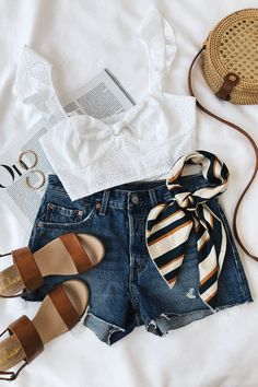 Cute summer/spring outfit idea for college girls. White top, tan sandals, and jean shorts.