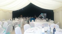 Black star cloth lining over the dance floor with round tables, chair covers and carpet. Wedding Marquee Hire, Marvel Wedding, Round Tables, Black Star, Chair Covers, This Is Us, Carpet, Floor, Dance