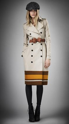 A modern take on their classic trench.  Love Burberry Prorsum's COLLEGE STRIPE TRENCH COAT from their Fall 2012 collection.