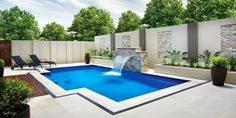 Small pool with wraparound patio and water feature