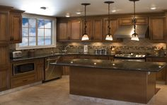 Love this color of cabinets and tile floor!