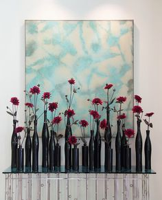 black vases, red single stemmed flowers