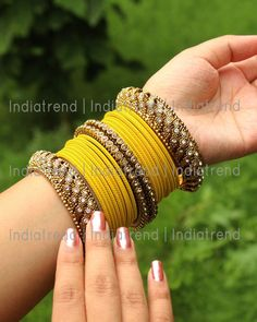 Azeen Bangle Set - 22 PC Matte Yellow Bangle Set With Golden Cz Bangle Size : or diameter . Base : High G - Indian Jewelry Earrings, Indian Jewelry Sets, Fancy Jewellery, Jewelry Design Earrings, Indian Wedding Jewelry, Stylish Jewelry, Fashion Jewelry, Egyptian Jewelry, Crystal Jewelry