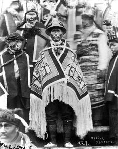 Group of Tlingit dancers in ceremonial dress; man in center [Dick Jetlnaboo] wears a Chilkat robe; those behind wear button blankets; all have nose rings Native American Tribes, Native American History, Native Americans, Tlingit, American Indian Art, Indigenous Art, People Art, First Nations, North West