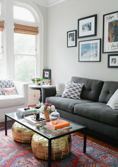 Grey couch, gold poufs, printed rug Apartment LOVE: Margaret Elizabeth