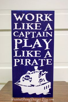 Wood sign saying: Work like a captain, play like a pirate | Vinyl home decor, children room, nautical design by Painted Peony Designs on Etsy. White and navy