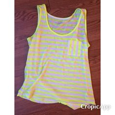 NEW LISTING Calvin Klein tank size XS Calvin Klein tank. White with bright yellow stripes. Size XS. In great condition! Calvin Klein Tops Tank Tops