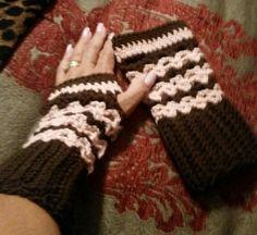 Brown and pink crochet fingerless gloves.