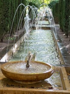 Palma de Mallorca, Spain... This water feature would be beautiful in a white garden ...