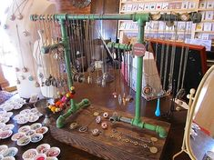 Pipes make a fitting display for necklaces made of hardware items. {craft booth setup} by danielle