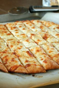 Cheesy Garlic Bread Sticks {just like in restaurants!} Use method with quick no rise pizza dough recipe.