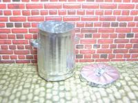 True metal trash can out of heavy aluminum foil | Source: Anna-Carin Betzen