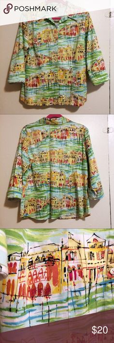 Artsy Venice street scene button front shirt Sz L Great shirt with a street scene that reminds me of Venice - the city with canals for streets!  Shirt has a bit of stretch for comfort and cuffs that can be worn down or turned up. 97% cotton and 3% spandex.  Shirt is 24.5 inches long from mid shoulder to hem down the front, sleeve measures 20 inches long or 18 inches with cuff turned up. Shirt measures 21 inches under arm to under arm laying flat, the waist is 20 inches laying flat, and hem…