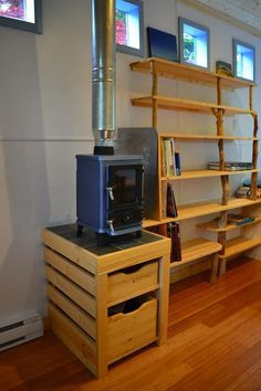 Good idea for using the space below the heater. I've seen so many with empty wasted space. - To connect with us, and our community of people from Australia and around the world, learning how to live large in small places, visit us at www.Facebook.com/TinyHousesAustralia