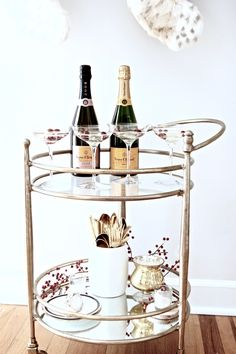 Gold bar cart styling with champagne + gold accents via For All Things Lovely   Easy holiday bar cart + entertaining with Horchow