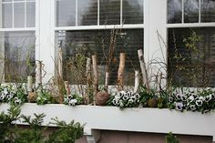 Adding birch logs & willow spheres to a flower box.  Itsy Bits and Pieces: A Visit to the Bachman's 2012 Spring Ideas House...