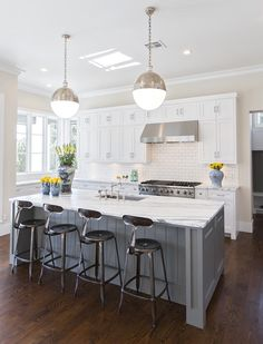 Hallie Henley Design **Love the contrast of darker floors with white cabinets. Gray island is nice too.