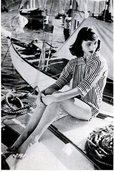 Elsa Martinelli in a brief middy of wool knit with drawstring around the hips by Mirsa, photo by Mark Shaw, on boat in harbor of Portofino, Italy 1955