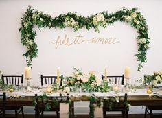 Floral Garland Hung On Wall To Frame Bride & Groom