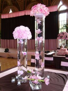 love the color scheme + tall centerpieces so guests can still see each other :)