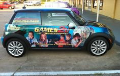 Vehicle Wrap Games2U Friendswood Texas.  Designed, printed and installed by Signquick.