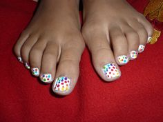 rainbow polka dot toe nails