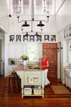 """7.) Don't Overlook Details - 7 Ways To Make a New (Old) House - Southernliving. """"We tried to re-create exactly how the house would have been built in every way,"""" says Kay. """"I wanted everything as vintage as possible."""" Glass doorknobs add charm to the baths. Most light fixtures in the house operate with a push button, and some function with an old-fashioned pull-down chain. In the kitchen, Kay concealed a Sub-Zero refrigerator with an intricately crafted stained oak panel complete with…"""