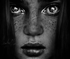 Stunning photograph of a freckled girls face in black and white - cristina otero