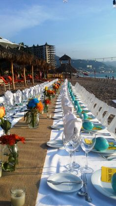 A fun reception set up on the beach! Keep all your guests together with one long table #NowAmber