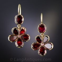 """Georgian"" Garnet Earrings. Delightful, dusky mid-nineteenth century ear drops glisten and glow with flat, foil-backed wine red garnets arrayed in a classic flower design. Dark and romantic antique jewels equally alluring by daylight and candlelight"