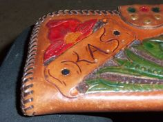 hand tooled and colored , ineed to buy more kits want me to make you one, this one is about 75.00, custom i swivel cut the letters the flowers were stamped mostly swivel cut and I worked the leather