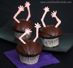 """Zombie Cupcakes. So EASY to make these arms/hands. They don't have to be creepy--could be """"Applause"""" or """"High Fives"""" Cupcakes for a congratulations treat."""