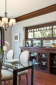 Dining room with large side buffet - with medium hardwood flooring.