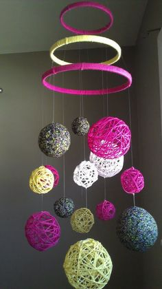 Pink and Yellow Yarn & Fabric Ball Baby Mobile. $60.00, via Etsy. This would be extremely easy to make!