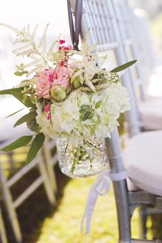 Love the gorgeous jelly jars on the back of the chairs. Perfect for an olive grove wedding theme.
