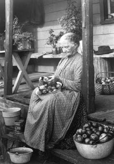 Pioneer women peeling apples- that she had to grow and pick first. Next will slice and dry, make pies, cook down into applesauce, etc. Recipes in #egggravy by #lindahubalek.