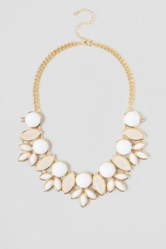 """The Perla necklace is composed of white beads and stones of varying sizes & shapes rimmed in gold. This beaded necklace adds instant style to any ensemble. Wear with a solid tank and printed shorts for a spring forward look.<br /> <br /> - 19"""" max length<br /> - lobster clasp<br /> - Nickle & Lead Free<br /> - Imported"""