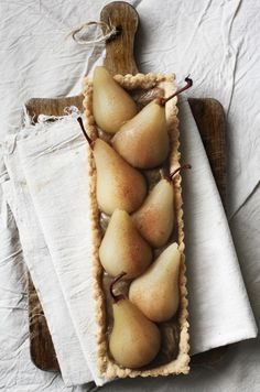 riesling poached pear tart with chai spiced custard & almond crust by caitlin