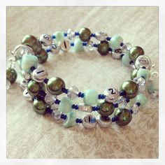 FREE SHIPPING Lovely Glass Bead Nursing Bracelet by PrairieDustInc, $35.00 Mom Jewelry, Jewelry Shop, Faceted Glass, Glass Beads, Nursing, Shells, Aqua, Beaded Bracelets, Free Shipping