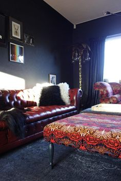 House of Hackney Peacock & Dragon fabric. Dark Interiors Alfred Anaglypta and Little Greene Lamp Black with oxblood leather chesterfield sofa. Eclectic interiors by Making Spaces