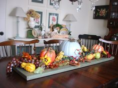 Dining room table with fall decor on an old shutter.