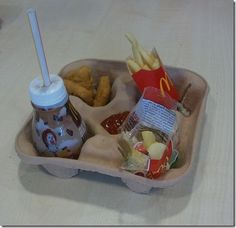 Easy kids tray for the car (it's a McDonald's drink carrier)