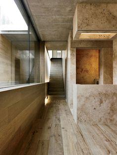 2 Verandas  Gus Wüstemann Architects  Zurich  Travertine marble in the guest bathroom on the ground level blends seamlessly with oak floorboards.
