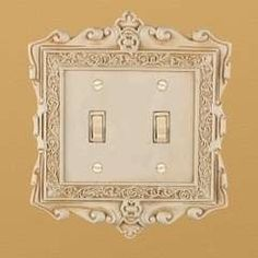 ornate, painted picture frame around light switch!