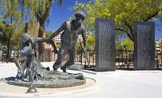 """Vietnam Veterans Memorial at Wesley Bolin Memorial Plaza in Phoenix, Arizona. The memorial was dedicated November 9, 2005. It consists of 10 columns of black granite engraved with the names of Arizonans killed or reported missing in action in Vietnam.  Jasper D'Ambrosi nationally acclaimed bronze artist of Tempe, Arizona, created the """"Fallen Warrior"""" sculpture. It portrays young soldiers as war's victims as much as war's heroes."""