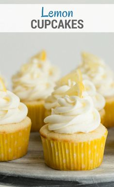 Lemon Cupcakes filled with lemon curd and topped with lemon buttercream frosting. These Lemon filled cupcakes remind me of lemon drop candies, so sweet and tangy! via @introvertbaker