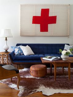 Blue Couch in Eclectic Living Room with Swiss Flag  - on HGTV