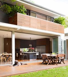 Sydney Family Home Extension  Bifold doors at the rear of the home are often found wide open, creating a vast living area. Retractable awnings from Markilux.