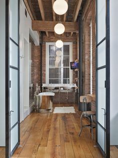 Jane Kim Design: Fabulous urban apartment style bathroom with exposed brick walls, rustic wood beamed ...