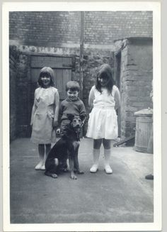 Oral history interviewee John McGuirk's family in their backyard Bootle Liverpool, c.1965